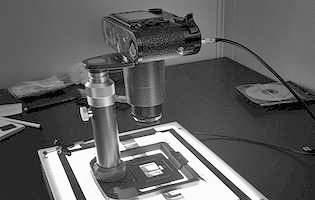Leica BEOON/16511 camera stand being used to photograph black and white negatives.